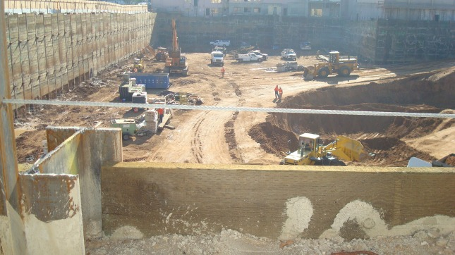 Workers preparing the foundation for the Columbia Square project.