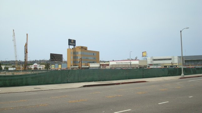 The fence surrounds a large empty parcel just across the street from the MTA site.