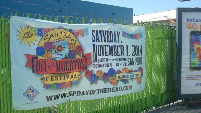 Banner advertising a Dia de los Muertos celebration on Harbor Boulevard.