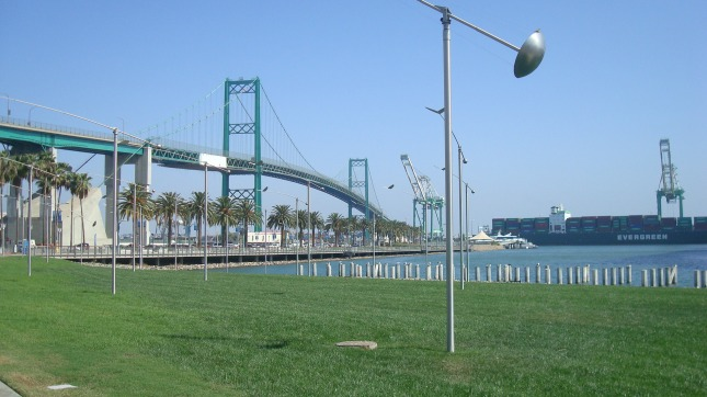 A park at the water's edge, with the Vincent Thomas Bridge in the background.