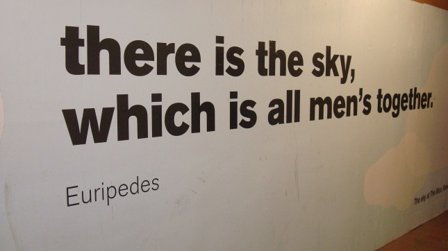 Construction barrier with a quote from Euripides.