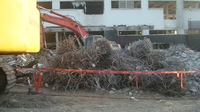Heavy machinery and piles of debris.