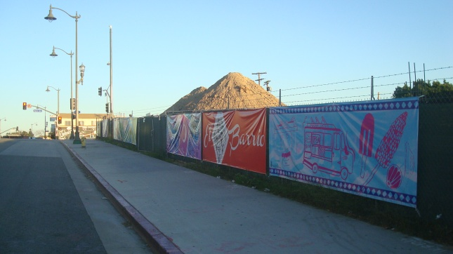 A row of banners at a construction site, First and Boyle