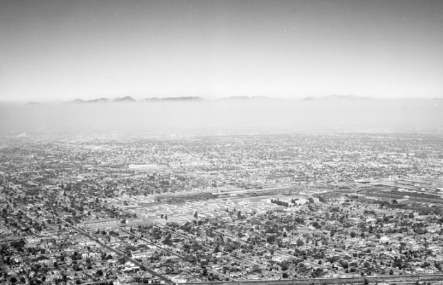 Aerial view of Watts, looking northeast. Jordan Downs can be seen at lower center.  Photo by Howard D. Kelly, 1956.  From the Los Angeles Public Library, Kelly-Holiday Collection.