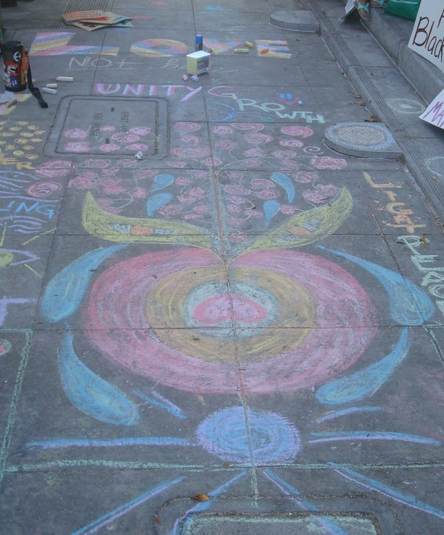 Chalk drawings on the sidewalk in front of City Hall.
