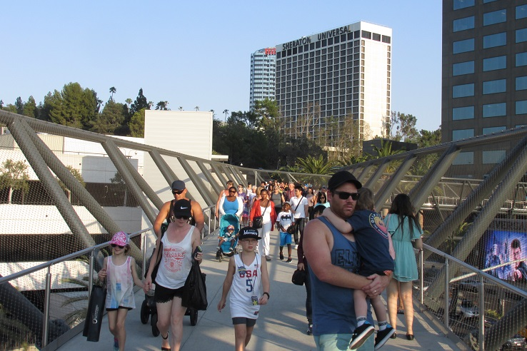 A crowd of people leaving the theme park.