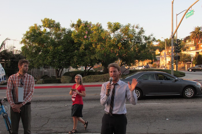 Noah Grynberg, of LACCLA, speaks to the crowd.